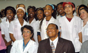 epa00672984 Louis Farrakhan (R-first row) leader of the Nation of Islam, smiles during a meeting with USA students of the Latinamerican Medical Science School on Monday 20 March, 2006 in Havana, Cuba. Farrakhan is on an 8-day visit to Cuba. EPA/STR Stringer